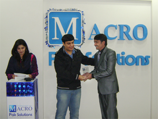Mr. Faizan Aslam distributing Awards