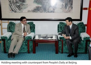 Holding meeting with counterpart from People's Daily at Beijing